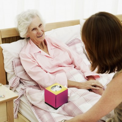 Elderly Senior Home Care Frail Woman in Bed