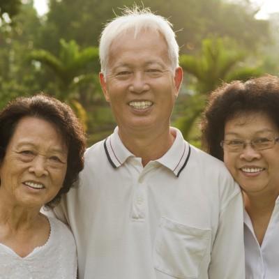 Three Senior Asian Smiling happily at park in a morning.